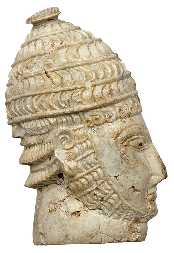 Head of helmeted warrior. Late Helladic ΙΙΙΑ–Β (14th–13th centuries BC). Hippopotamus ivory. H. 0.08 m, w. max. 0.05 m, th. 0.023 m. Mycenae, Chamber Tomb 27. Athens, National Archaeological Museum, 2468.