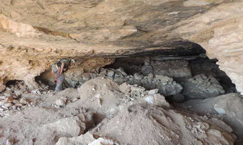 The Cave of Skulls and the damage inside it. Credit: Israel Antiquities Authorities.