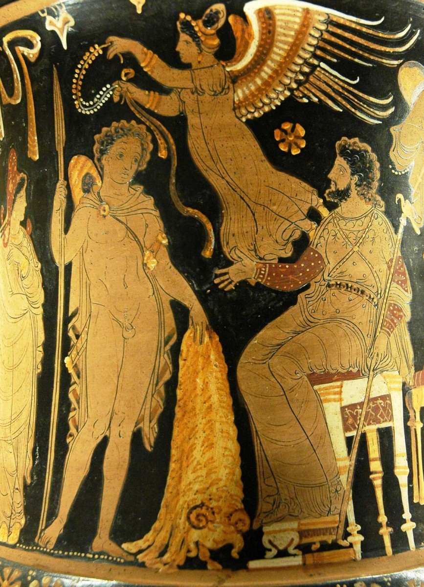 Jason bringing Pelias the Golden Fleece; a winged victory prepares to crown him with a wreath. Side A from an Apulian red-figure calyx crater. 340-330 BC. Louvre Museum.