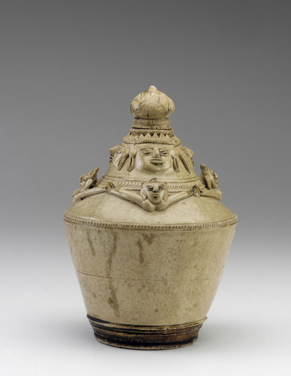 Bottle with four male faces above four female torsos with outstretched hands. Late 12th-13th c. Angkor period. Stoneware with iron pigment under wood-ash glaze Cambodia or Northeast Thailand. The Smithsonian's Museums of Asian Art.