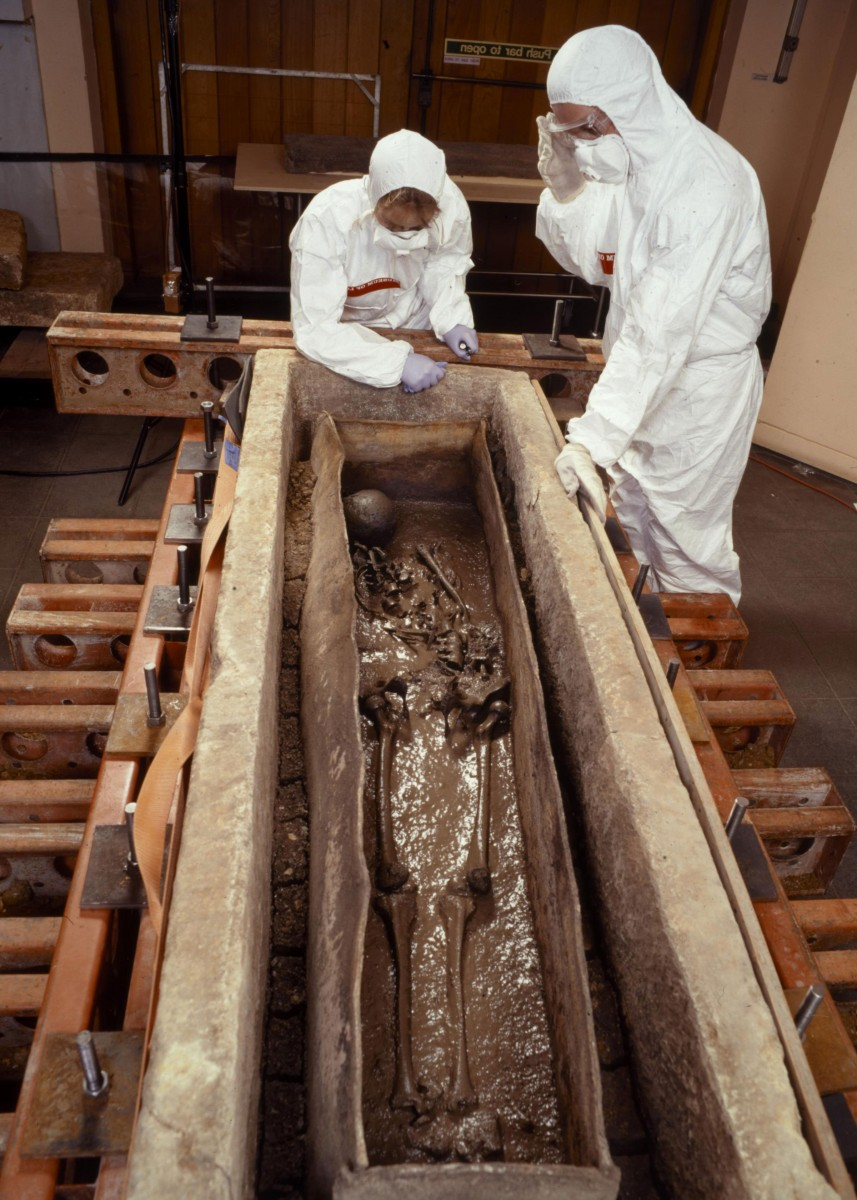 The Roman Lady's coffin is opened at The Museum of London in 1999. Silt in base contained evidence of mastic and pine resins. Photo Credit: Museum of London.