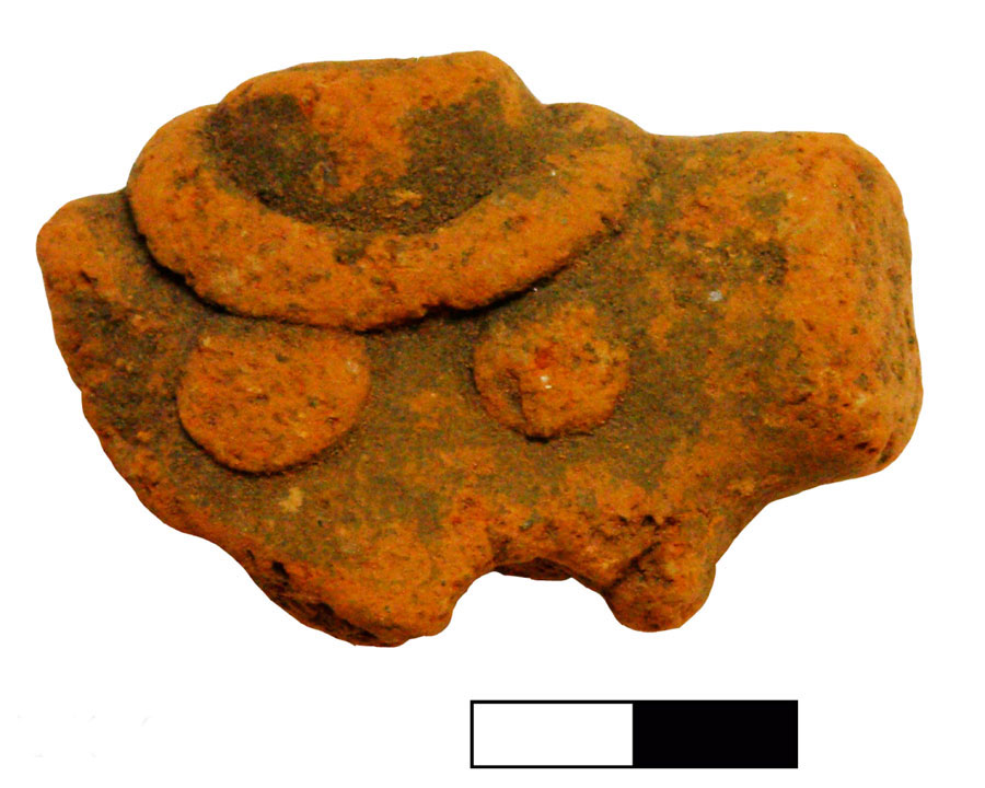Fig. 9. Chest part of a human figurine, with banded necklace. Vrysinas's Peak Sanctuary (C. Davaras, exc. 1972-73); SN 750.