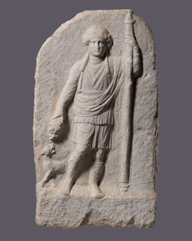 Votive relief dedicated to Dionysus. The stylistic type of beardless Dionysus is common during the Hellenistic and Roman period. Unknown provenance . Late 1st c. BC - early 1st c. AD.