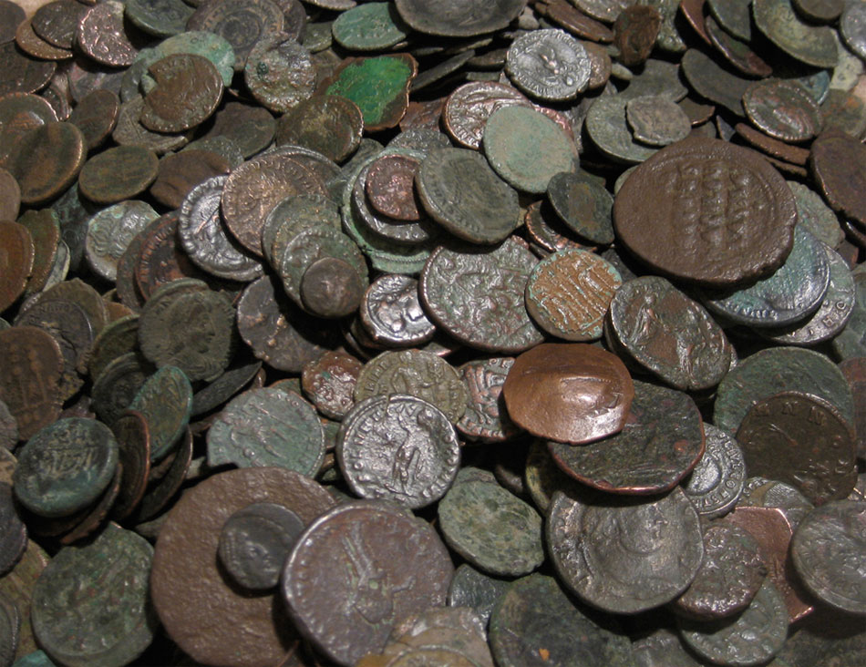 Coins and pieces of gold were found inside the tomb. (archival photo)