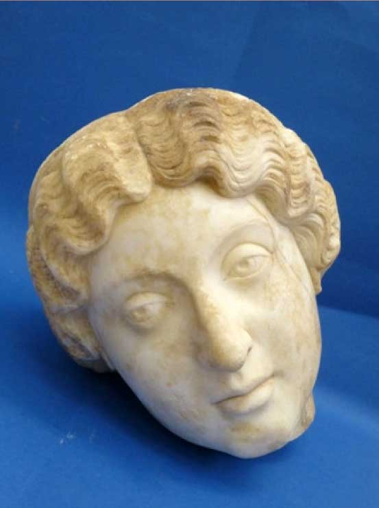 Marble statue head representing the Roman Empress Faustina. 2nd c. AD. Archaeological Museum of Patras. Photo: Ephorate of Antiquities of Achaia.