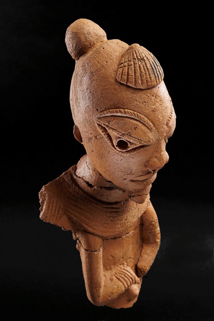 A small terracotta figure of a man, decorated on the forehead with a relief in the form of a seashell. Unearthed in 2012 at the Pangwari site. (Copyright: Peter Breunig)