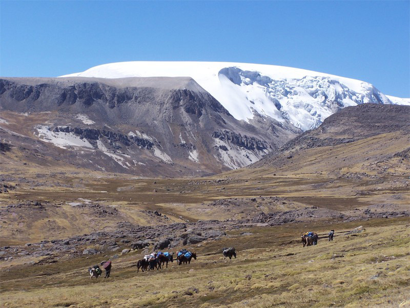 The north dome of the Quelccaya Ice Cap in Peru in 2003. Researchers at The Ohio State University found evidence of human-produced air pollution within the ice that predates the industrial revolution by more than 200 years. Photo by Paolo Gabrielli, courtesy of The Ohio State University.