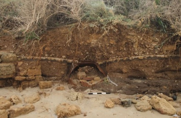 The dolium unearthed by the storm. Photo Credit: Israel Antiquities Authority