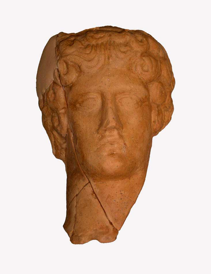 Head of a male figurine, probably featuring god Apollo. Archaeological Museum of Arta. Credit: Archaeological Museum of Arta.