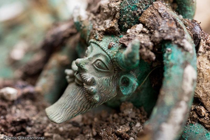 Handle of a bronze cauldron representating the Greek God Acheloos. © Denis Gliksman, Inrap