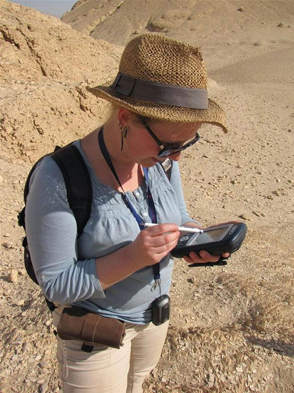 Julia Chyla, archaeologist and GIS specialist, at work with mobile GIS device. Photo Credit: W. Ejsmond.