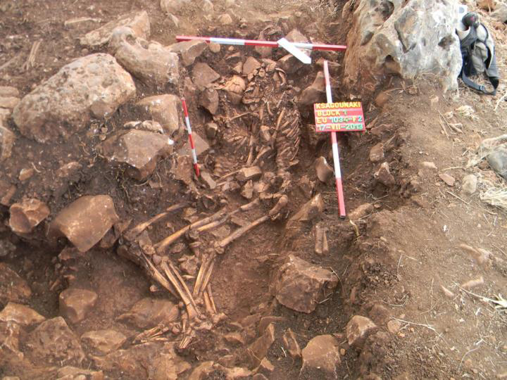 This image shows the tinal Neolithic burial of a man (right) and a woman (left) buried in an embrace at Ksagounaki, ca. 3800 BC. Credit: Photograph courtesy of The Diros Project.
