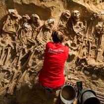 More than 200 bodies found  in communal graves beneath Paris supermarket