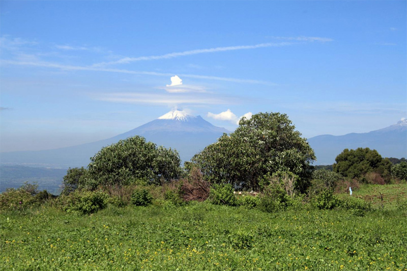 View to the west from the heights of Tlaxcallan. The active volcano, Popocatepetl, is visible in the background. Image: Lane Fargher.
