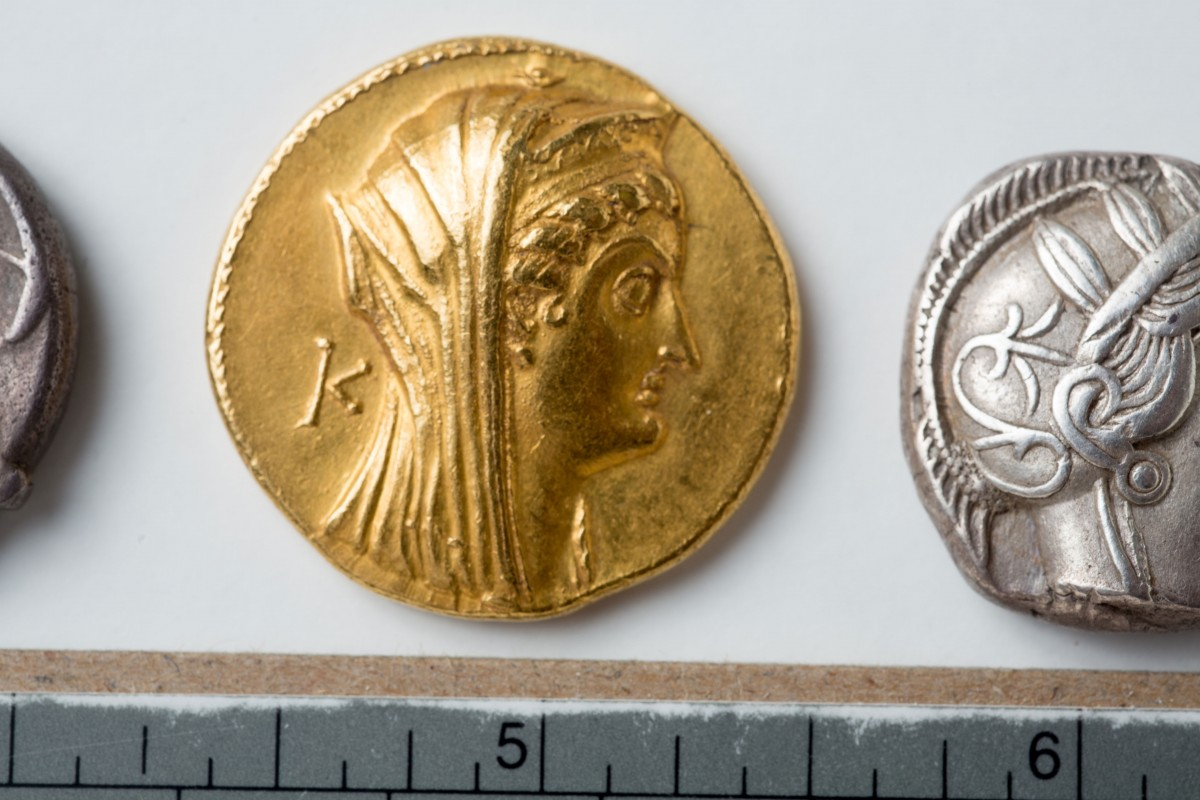Obverse (heads) of a gold octodrachm of Arsinoe II (285 to 246 B.C.). Photo Credit: Douglas Levere/