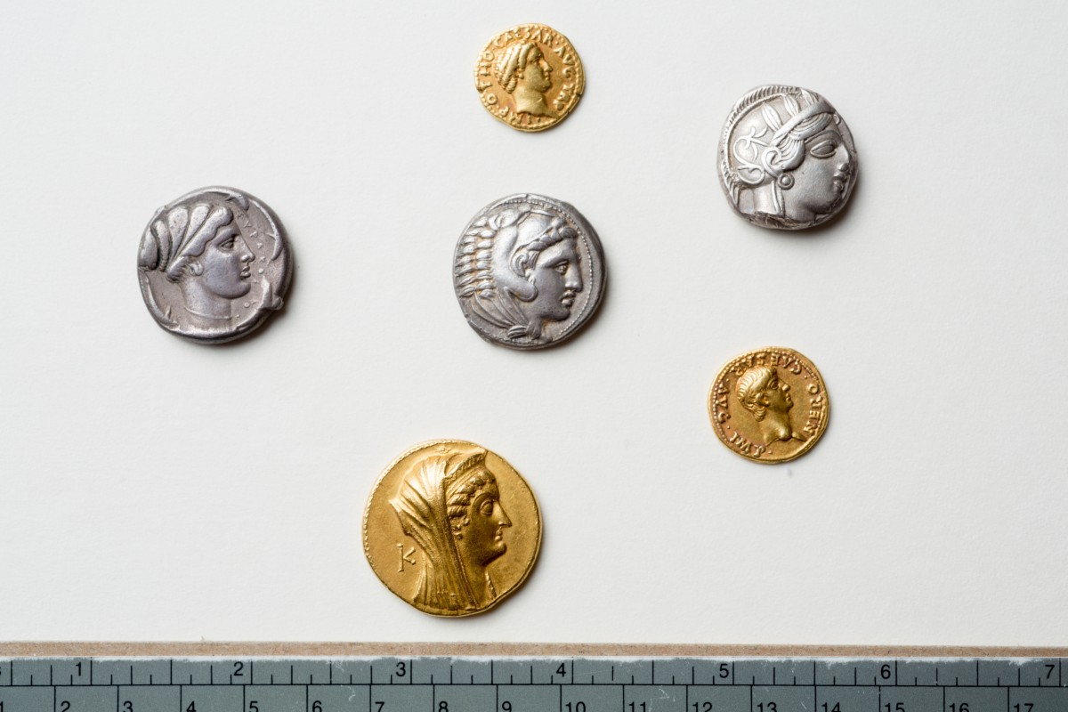 Gold and silver coins from the collection discovered at the University of Buffalo Libraries. Photo Credit: Douglas Levere.