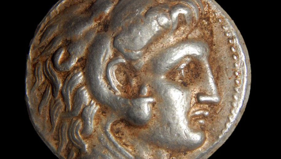 A coin from the period of Alexander the Great, part of the hoard discovered hidden in a cave in northern Israel, February 2015. Photo Credit: Samuel Magal/Israel Antiquities Authority.