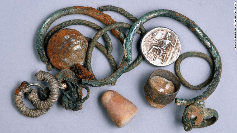 The find includes ancient coins,rings, bracelets, earrings and a small stone weight. Photo Credit: Clara Amit / Israel Antiquities Authority.