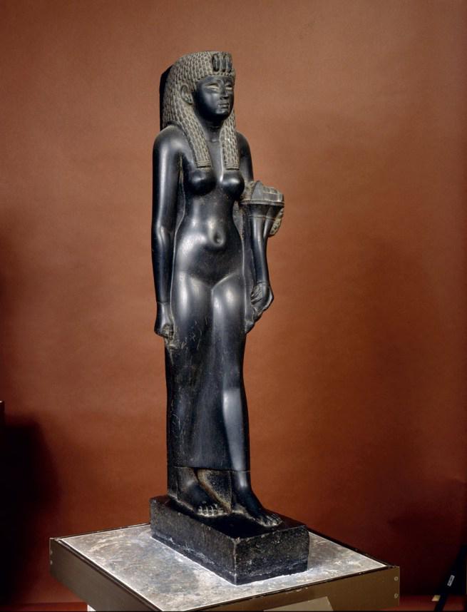 Figure of Cleopatra VII, Egypt. 51-30 BC. Basalt,  h 104 cm. © State Hermitage Museum, St Petersburg  .
