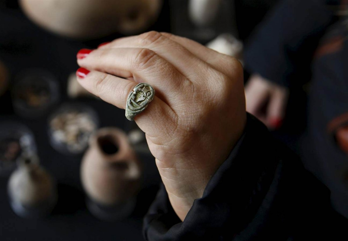 Yoli Shwartz, a spokeswoman for the Israel Antiquities Authority, wears an ancient seal ring that was discovered during  the excavation of a cave in southern Israel. The ring and other artefacts were displayed at the Rockefeller Archaeological Museum in Jerusalem on Wednesday. Photo Credit: Baz Ratner/Reuters.