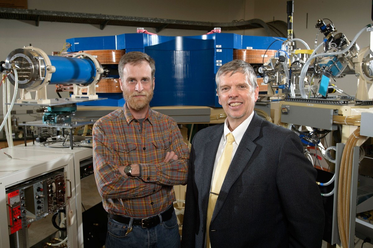 Purdue University professors Darryl Granger (left) and Marc Caffee stand in front of the gas-filled magnet detector in the Purdue Rare Isotope Measurement Laboratory. Photo Credit: Purdue University/John Underwood
