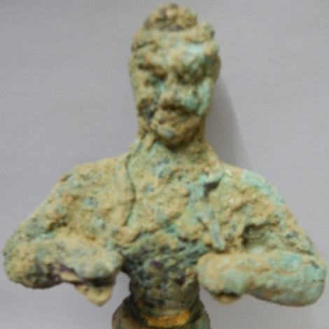 Middle-Minoan bronze figurine depicting a Kouros in a gesture of worship.