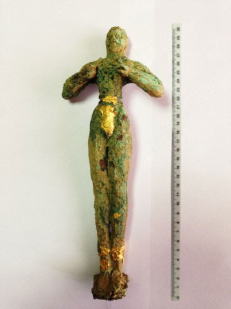 Middle-Minoan bronze figurine depicting a Kouros in a gesture of worship. .