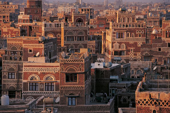Situated in a mountain valley at an altitude of 2,200 m, the Old City of Sana'a is defined by an extraordinary density of rammed earth and burnt brick towers rising several stories above stone-built ground floors, strikingly decorated with geometric patterns of fired bricks and white gypsum. Photo: UNESCO