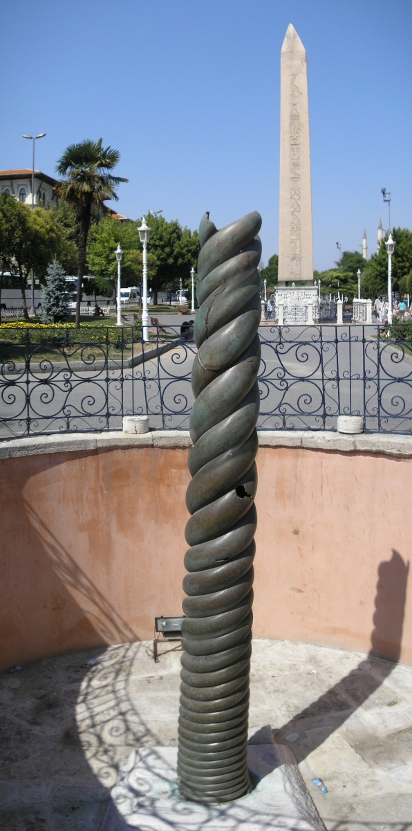 The Serpent Column in Constantinople. The Obelisk of Theodosius is seen in the background.