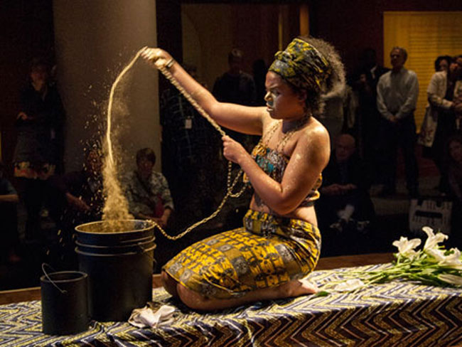 Fig. 4. The African artist Nathalie Mba Bikoro in a performance at the Smithsonian National Museum of African Art in Washington.