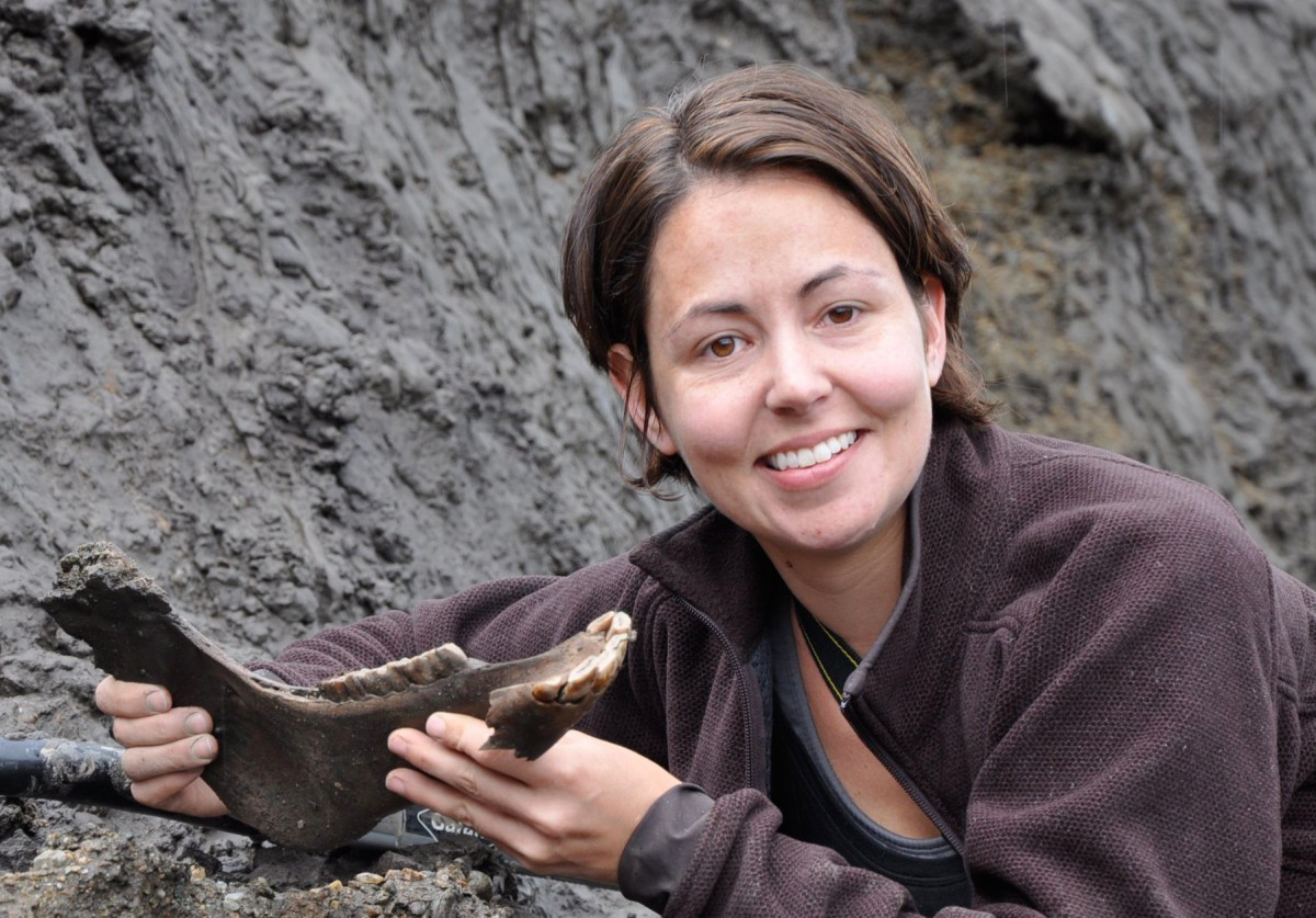In her book 'How to Clone a Mammoth',  Shapiro walks readers through the astonishing and controversial process of de-extinction. Here with Ice Age horse jaw. (Image courtesy of the Government of Yukon)