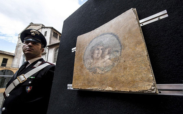 A frescoe of young woman with a cupid on the shoulders, one of the three frescoes stolen in 1957 in Pompeii. Photo Credit: EPA.
