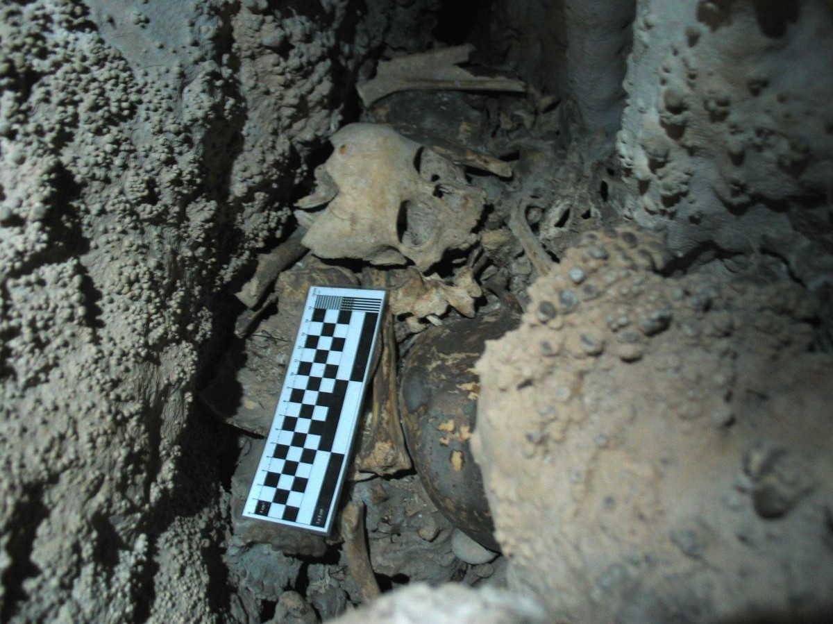 A crevice in the cave where human remains, including the skull of a child, can be seen. Credit: Image courtesy of University of Granada.