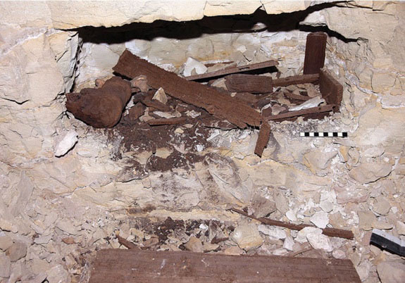 The remains of a wooden coffin in the catacomb that still has parts of the mummy within it. Photo credit: Live Science / P.T. Nicholson.