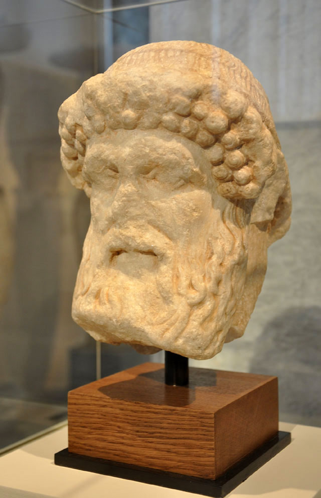 Marble head of Hermes featuring the gods as a guide of men.