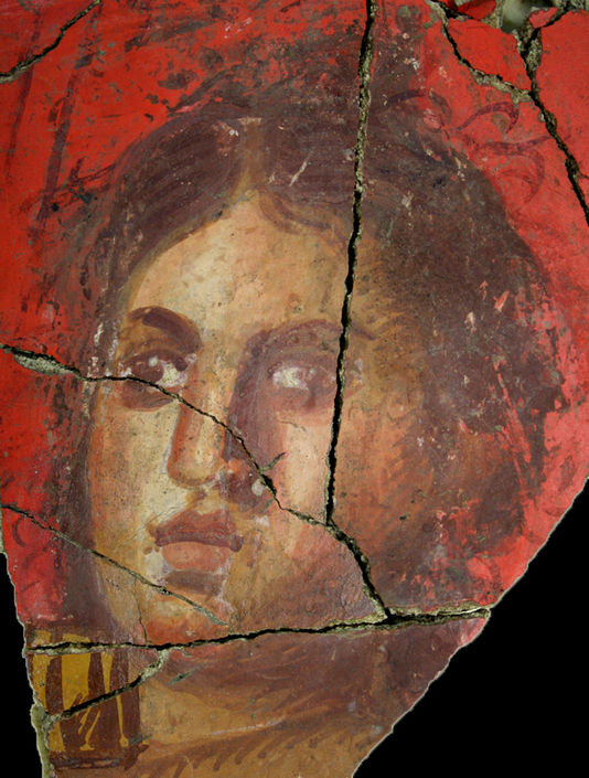 A detail of the fresco showing a young woman with highly expressive fetures. Photo Credit: Arles Museum of Antiques.