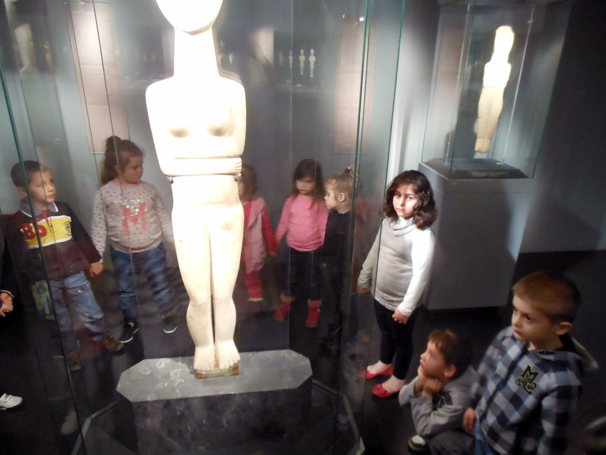 "Fig. 1. Snapshot of an activity from the educational programme entitled ""The circle of figurines"", at the Museum of Cycladic Art. Designed and implemented with the collaboration of the archaeologist Ms E. Markou (archive of V. Deligiannidis)."