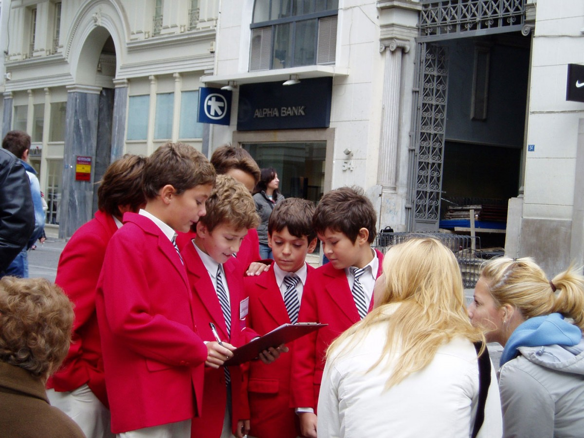 "Fig. 2. 5th grade pupils interview passersby as part of the programme called ""Kapnikarea. A monument in the centre of commercial Athens"" by the Directorate of Byzantine and Post byzantine Monuments, 2003."