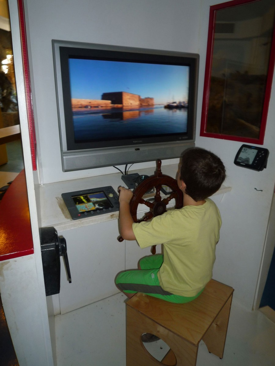 "Fig. 6. Natural History Museum of Crete, children's wing ""Discovery Centre"". On the boat children play the part of the captain and learn about life at sea (Photographic archive of D. Kalessopoulou)."