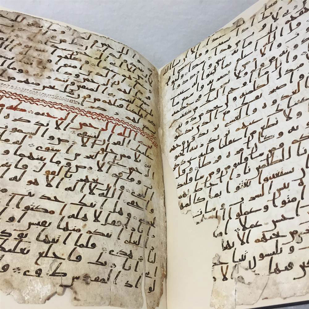 The manuscript consists of two parchment leaves covered in ink in an early form of Arabic script known as Hijazi. Photo Credit: The University of Birmingham.