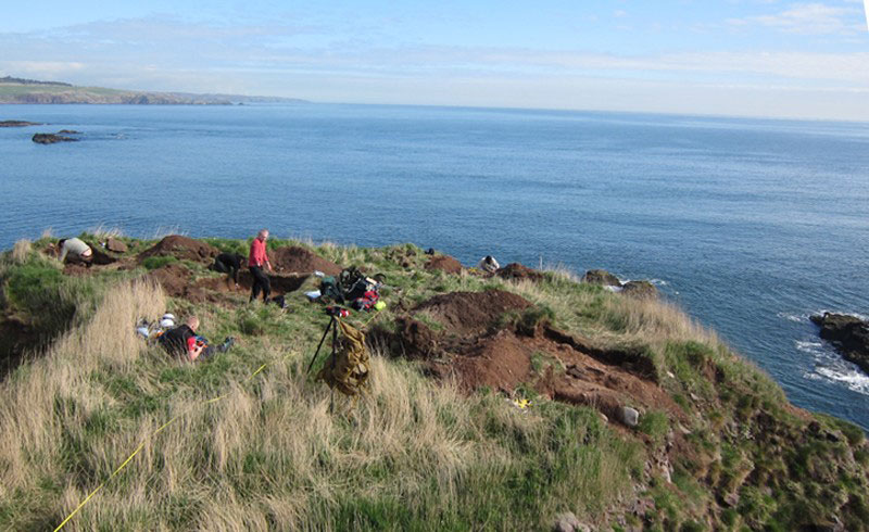 Excavations underway on top of Dunnicaer. Photo Credit: University of Aberdeen / Past Horizons.