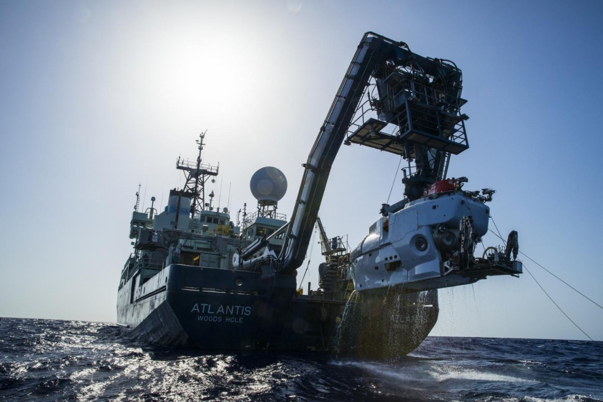 The research vessel Atlantis with the submersible Alvin hanging off its sterm. (credit: Luis Lamar, Woods Hood Oceanographic Institution).