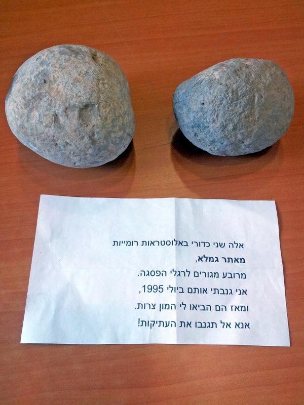 The two sling stones and the note explaining that they