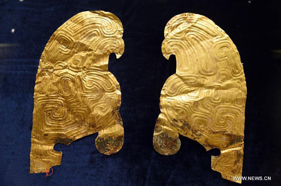 Photo taken on July 20, 2015 shows gold ornaments displayed at a public exhibition  of Chinese cultural relics returned by French private collectors, at Gansu Provincial  Museum in Lanzhou, capital of northwest China's Gansu Province  Photo Credit: Xinhua/Fan Peishen.