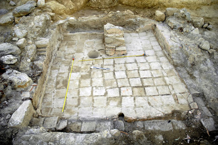 Fig. 9. A Roman era construction has violated part of the sanctuary to build a cistern. Sanctuary of Apollo Amyklaios.