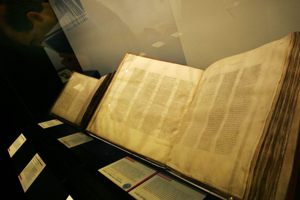 A Codex Sinaiticus manuscript, right, the earliest complete New Testament, from 4th century Egypt or Judea on display in the 'Sacred: Discover what we share' exhibition at the British Library in London, Wednesday, April 25, 2007 (AP Photo/Sang Tan).
