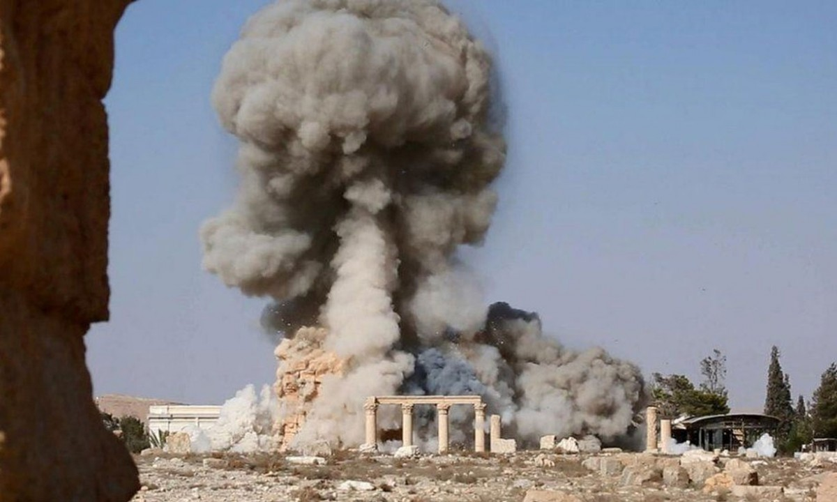 A few days ago the IS published pictures in social media, showing monuments at Palmyra being blown up. Photo Credit: The Guardian.