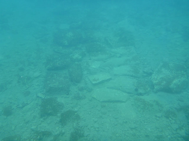 Stone foundation of the outer fortification wall. © Hellenic Ministry of Culture, Education and Religious Affairs