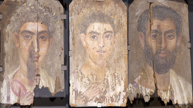 Roman-era Egyptian mummy portraits from the site of Tebtunis, Egypt, are shown in visible light, with no blue color apparent to the naked eye. In an unexpected discovery, researchers found the synthetic pigment Egyptian blue present in all three paintings. (Credit: Phoebe A. Hearst Museum of Anthropology, University of California, Berkeley)