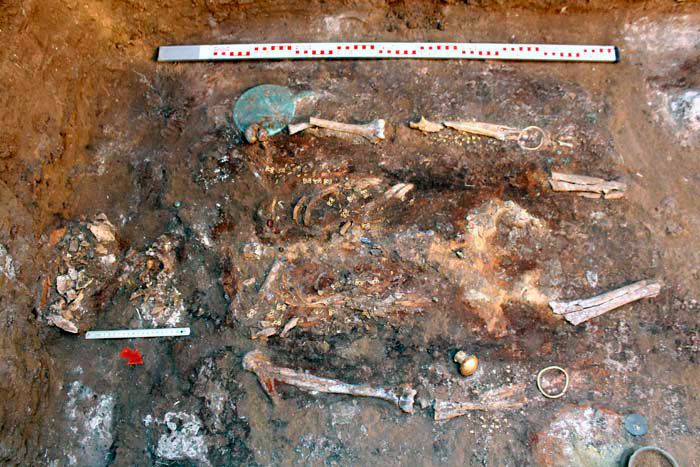 The Sarmatian woman's burial. One can see the bronze mirror and the bracelets (on each hand of the woman) [Credit: Institute of Archaeology, Russian Academy of Sciences].